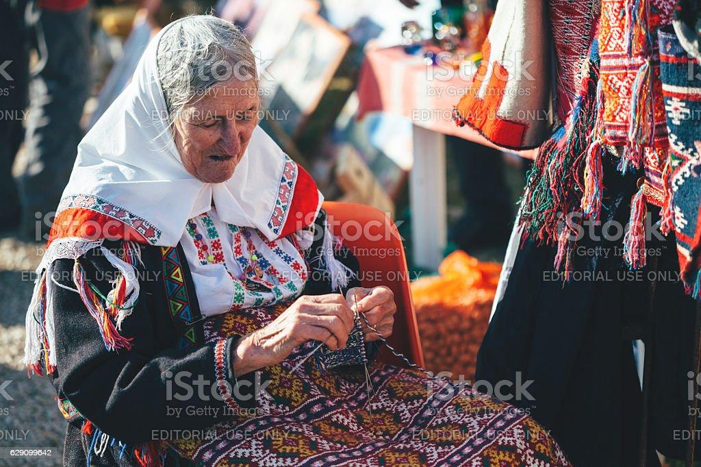 Grandma prepares traditional costumes stock photo