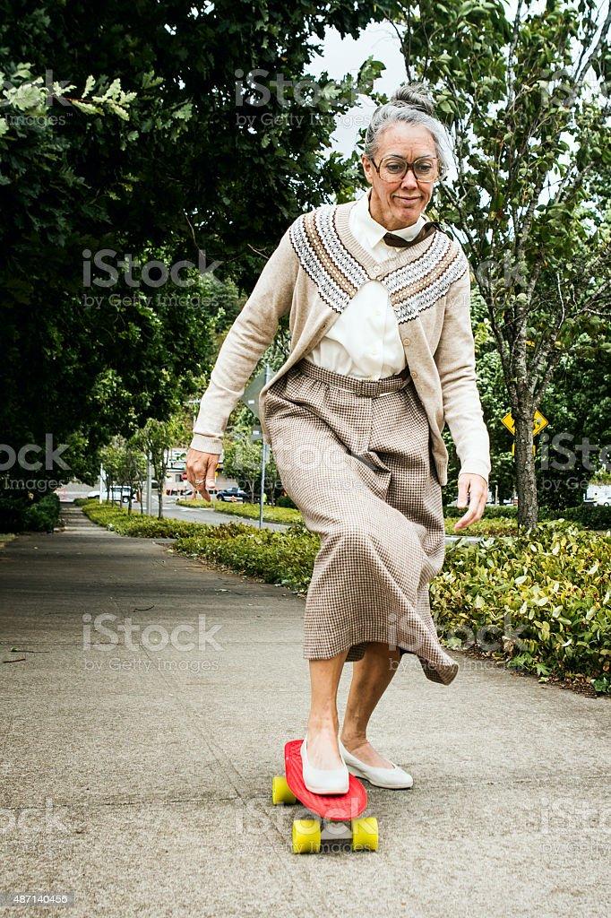Grandma Riding on Skateboard stock photo