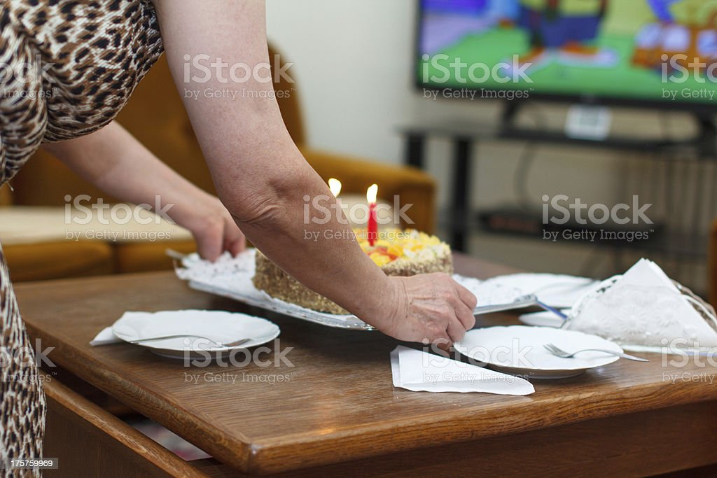 Grandma serving birthday cake royalty-free stock photo