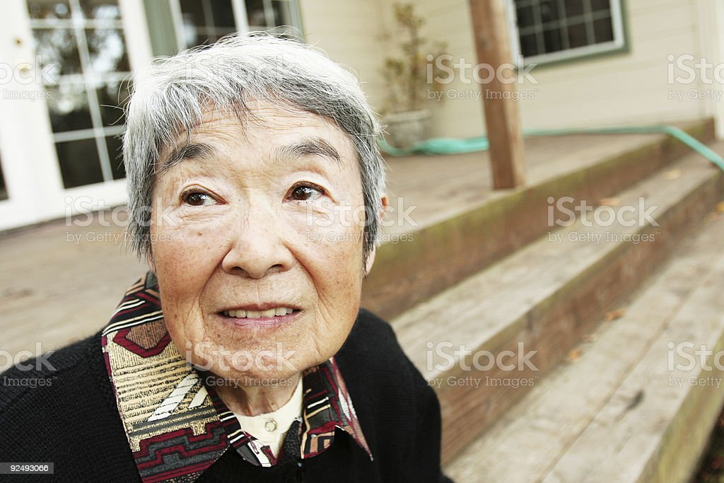 Grandma Sitting Outside on the Porch royalty-free stock photo