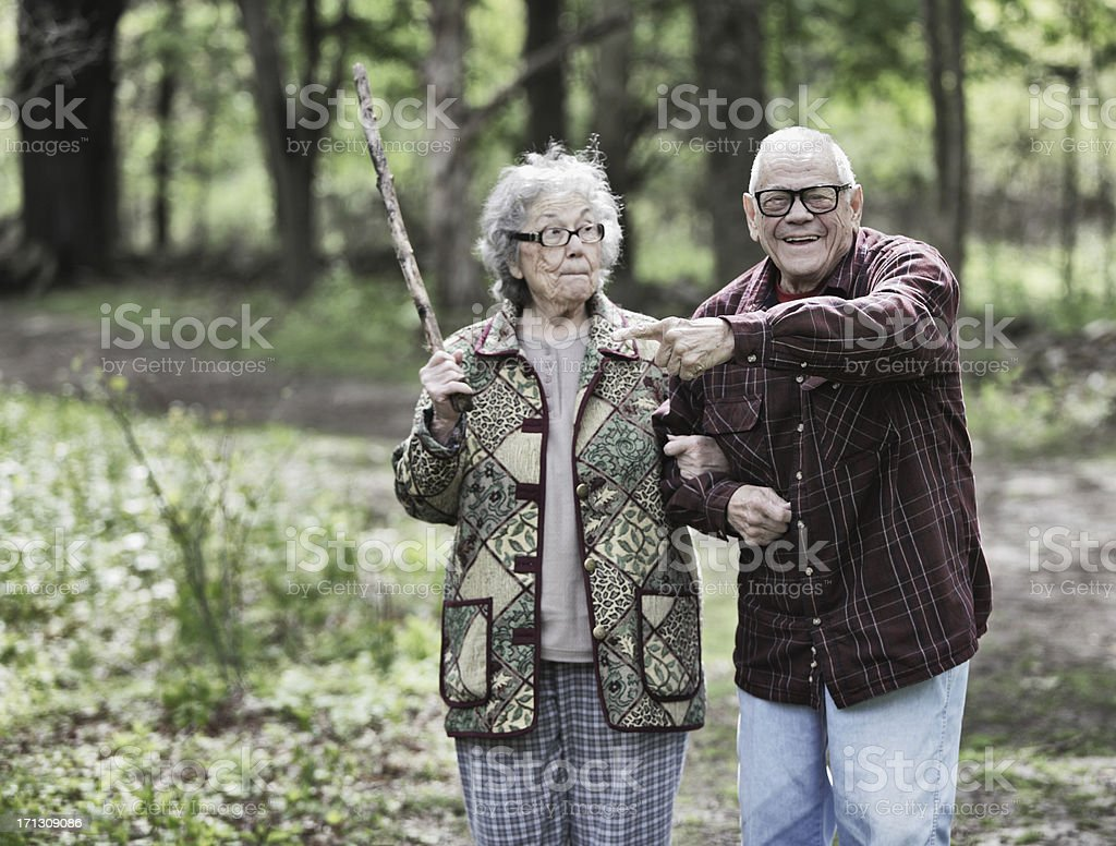 Grandma Swinging Stick at Grandpa stock photo