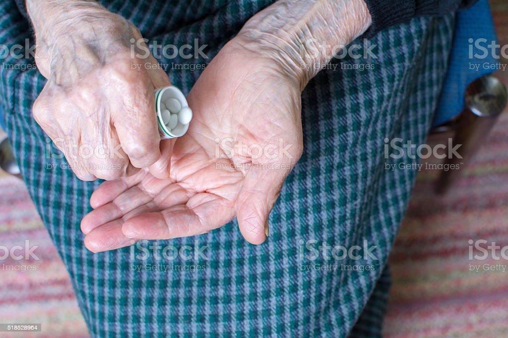 Grandma taking pills stock photo