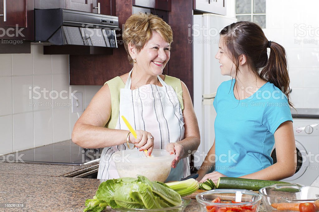 grandma talking to granddaughter in kitchen royalty-free stock photo