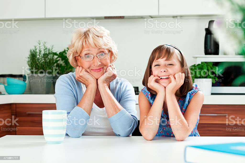 Grandma with granddaughter in the kitchen royalty-free stock photo