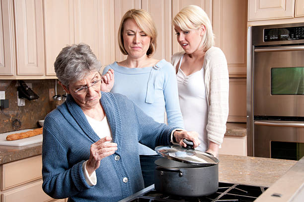 grandmas suprise cooking dish - mom spying stock photos and pictures