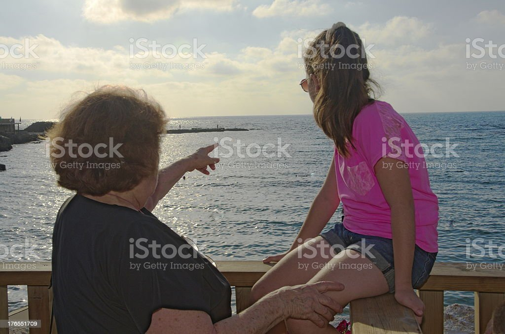 Grandmother and granddaughter admiring the Mediterranean view royalty-free stock photo