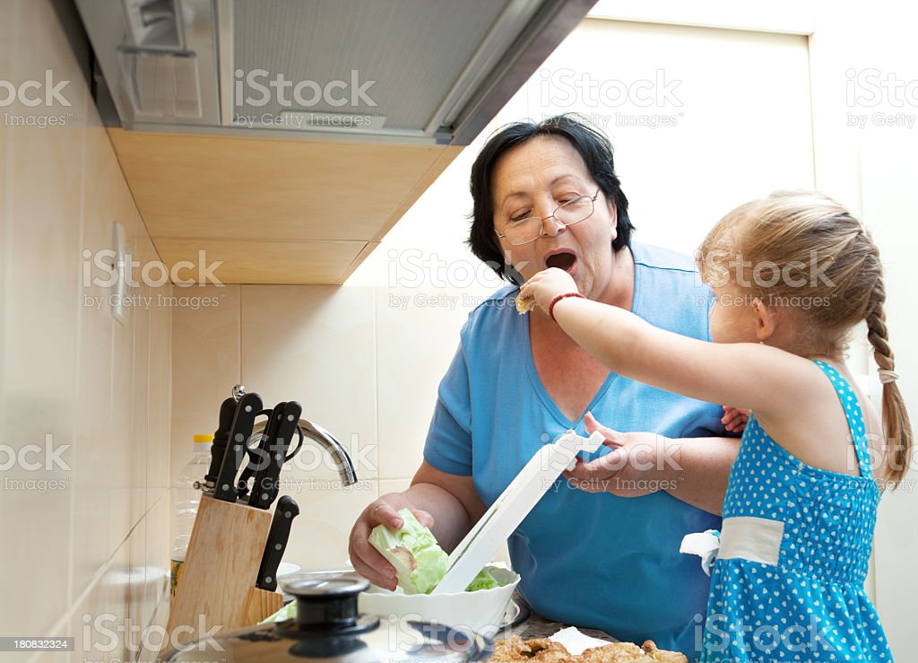 Grandmother and Granddaughter are in the Kitchen royalty-free stock photo