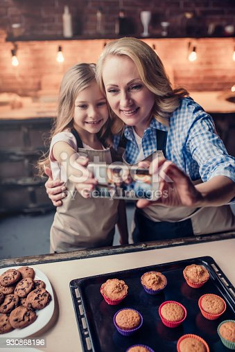 istock Grandmother and granddaughter cooking on kitchen 930868196