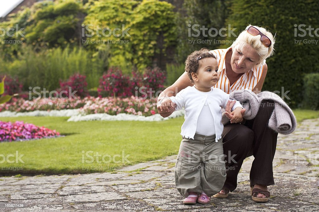 Grandmother and Granddaughter Enjoying Time in Park( serie) royalty-free stock photo