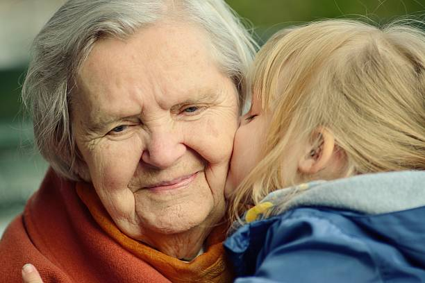 Grandmother and granddaughter. Happy family. stock photo