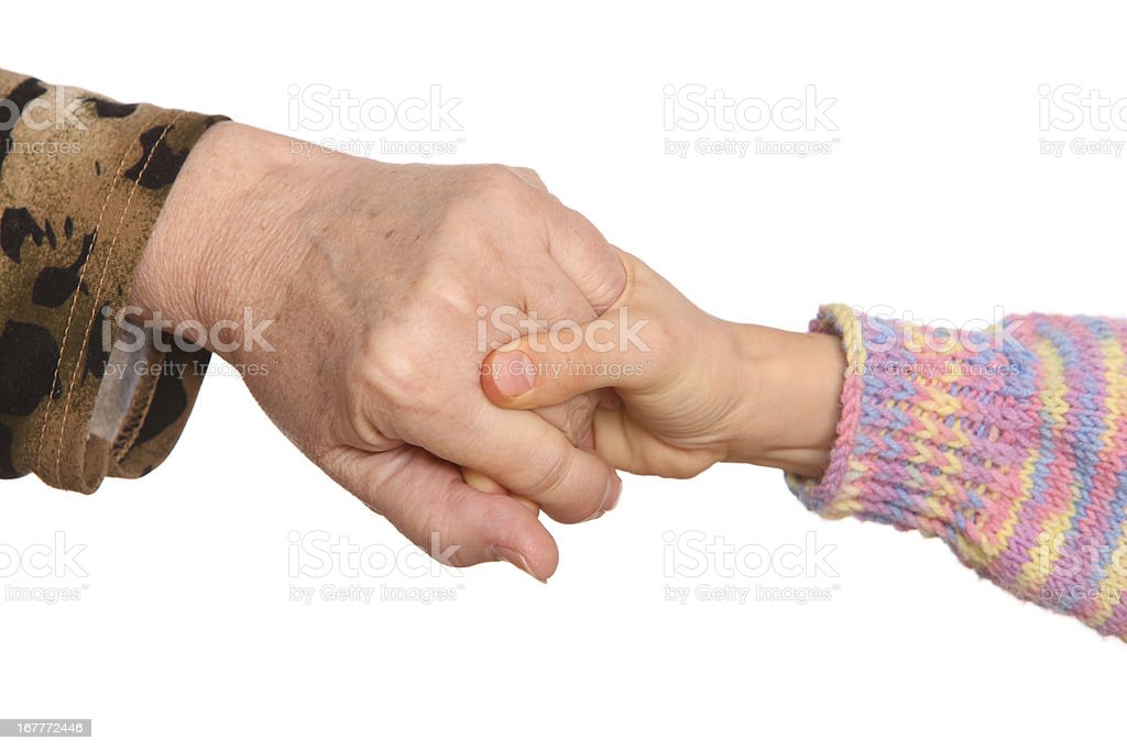 Grandmother and granddaughter hold hands. royalty-free stock photo