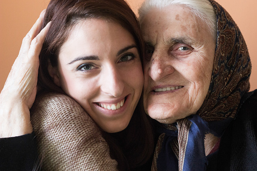 144362548 istock photo Grandmother and granddaughter hugging, smiling 636399884