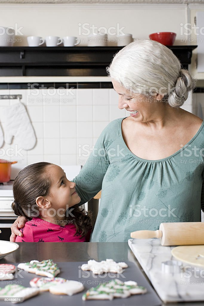 A grandmother and granddaughter in a kitchen royalty-free 스톡 사진
