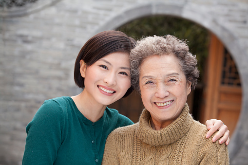144362548 istock photo Grandmother and granddaughter in front of round arch, Beijing 472049649