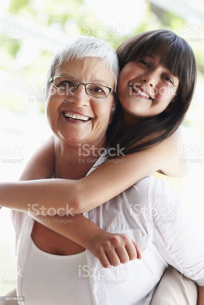 Grandmother and granddaughter in playful mood royalty-free stock photo