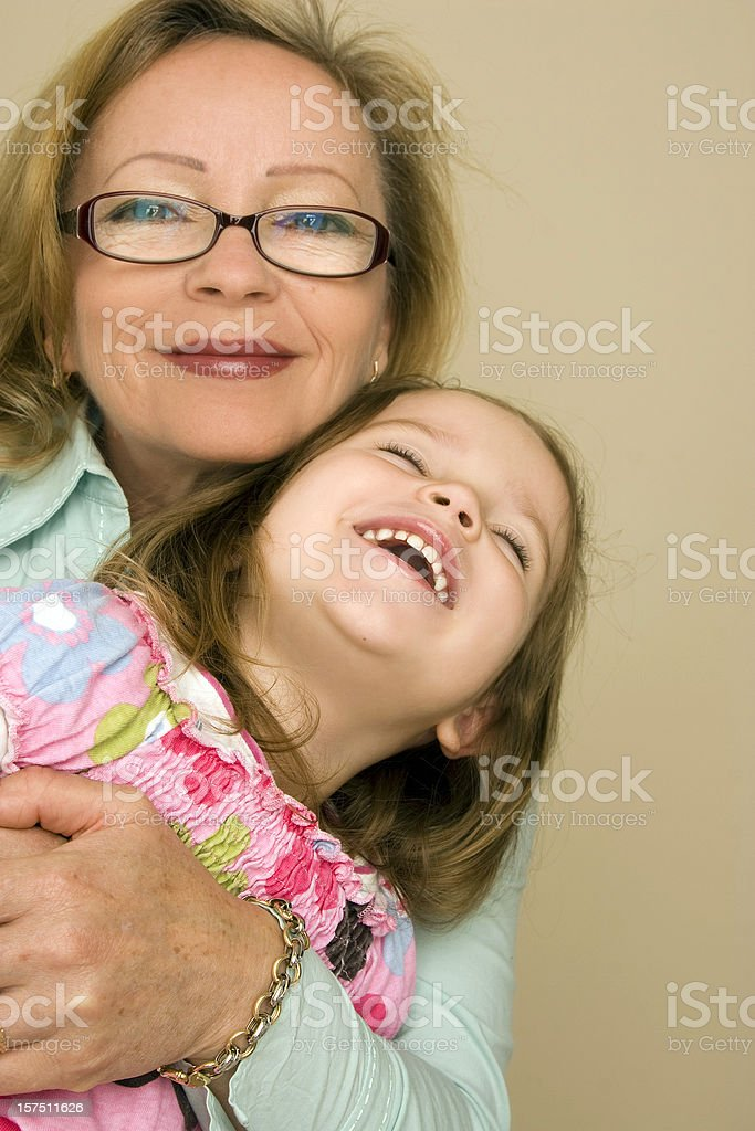 Grandmother and Granddaughter laughing royalty-free stock photo
