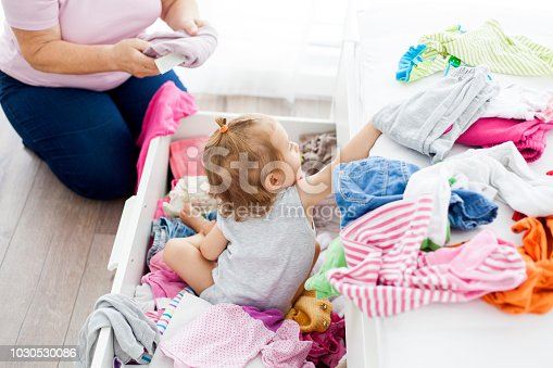 grandmother and granddaughter organize clothes