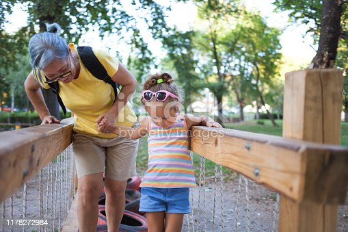 Close up of Grandmother and granddaughter playing outdoors