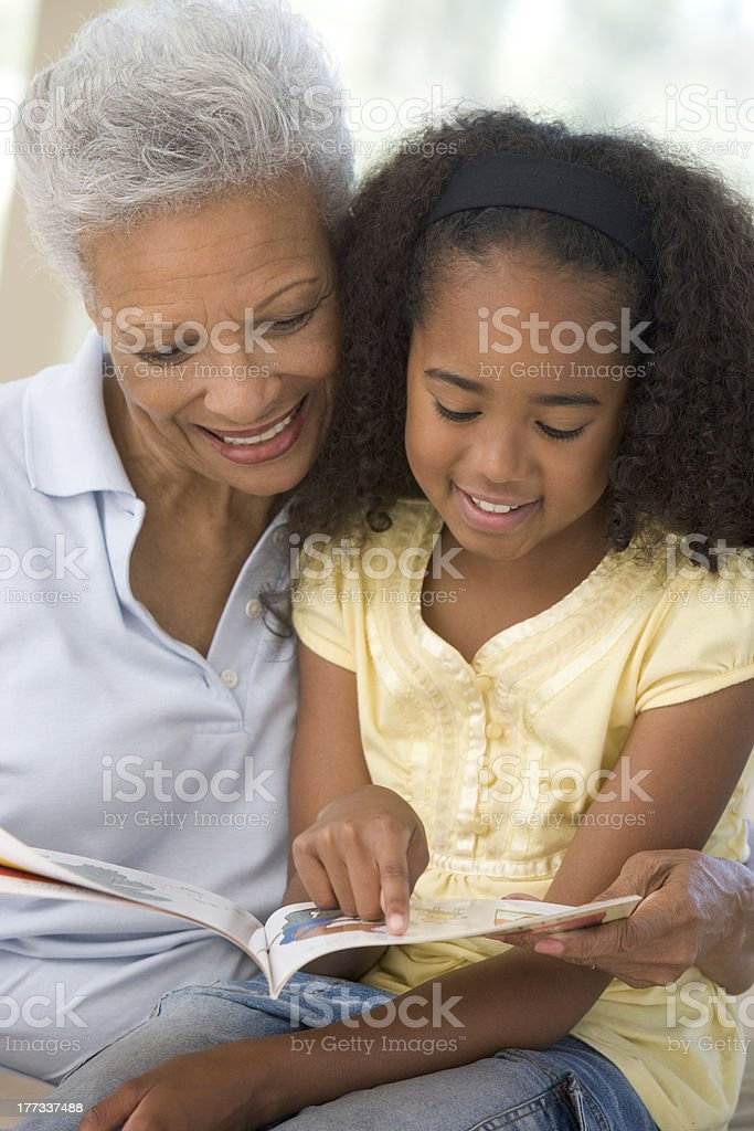 Grandmother and granddaughter reading stock photo