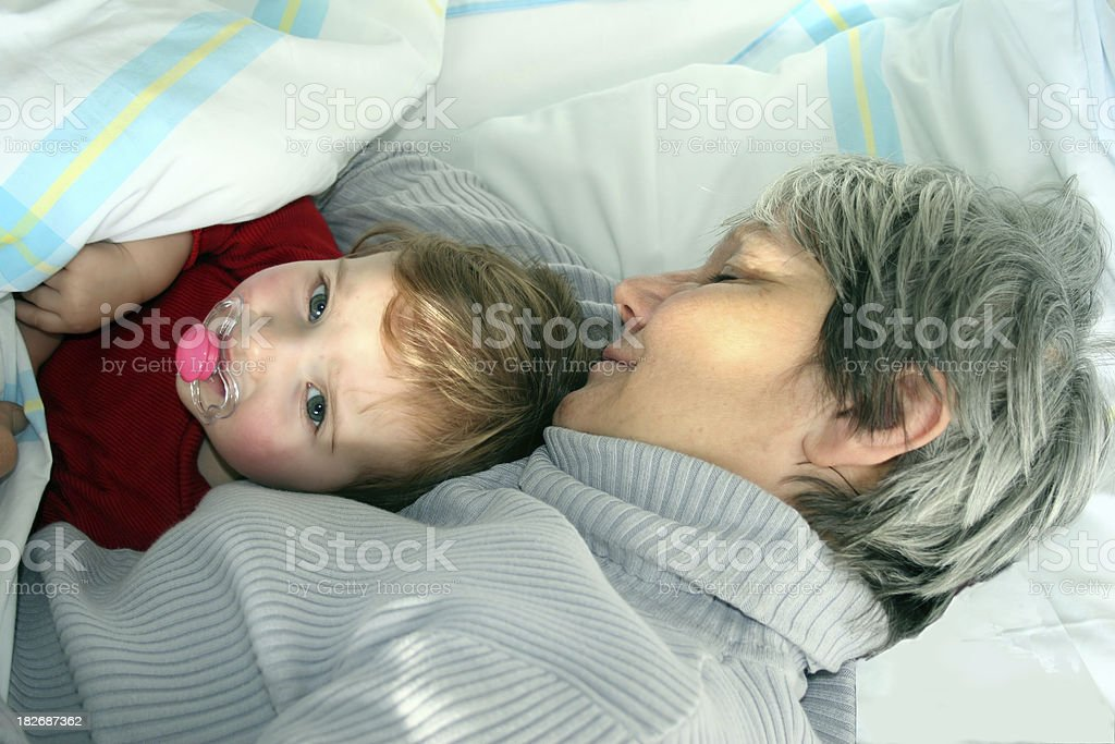 Grandmother and granddaughter taking a nap royalty-free stock photo