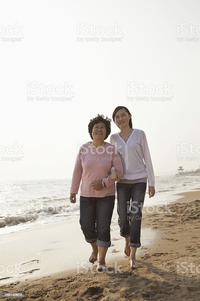 Grandmother and Granddaughter Taking a Walk by the Beach royalty-free stock photo