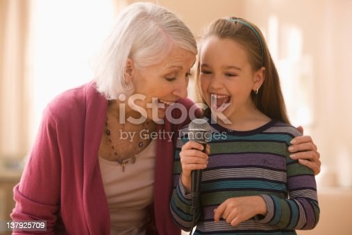 istock Grandmother and granddaughter with microphone 137925709