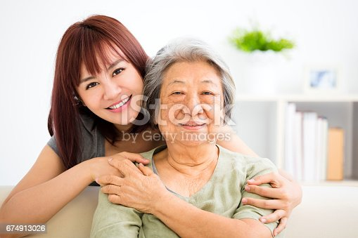 istock Grandmother and granddaughter. Young woman carefully takes care of old woman 674913026