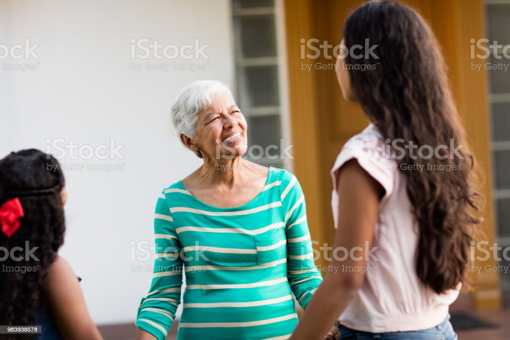 Grandmother and granddaughters standing outside - Royalty-free 12-13 Years Stock Photo
