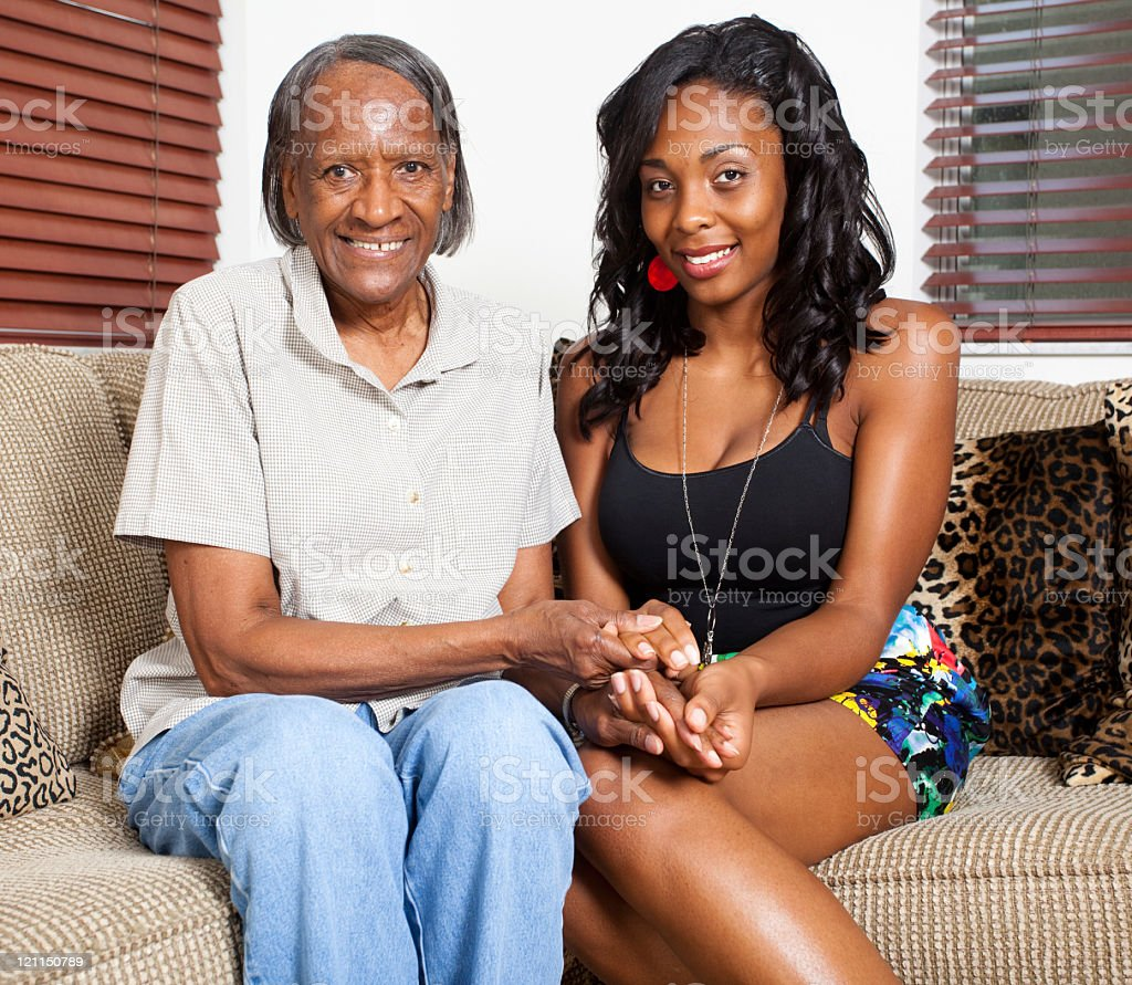 Grandmother and Granddoughter smiling into the camera stock photo