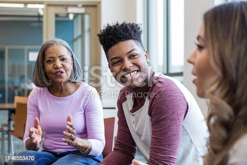 istock Grandmother and grandson look to therapist for affirmation 1146553470