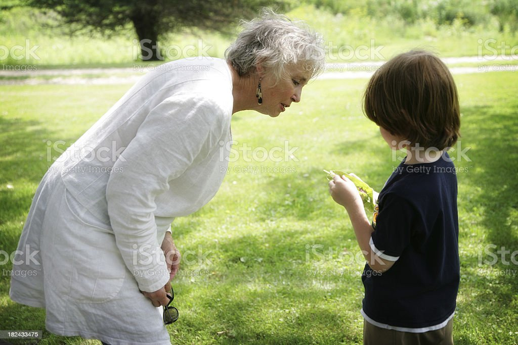 Grandmother and Grandson Looking at Things in Nature royalty-free stock photo