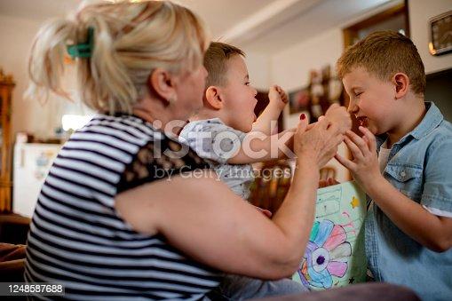 Grandma and grandchildren spending time together