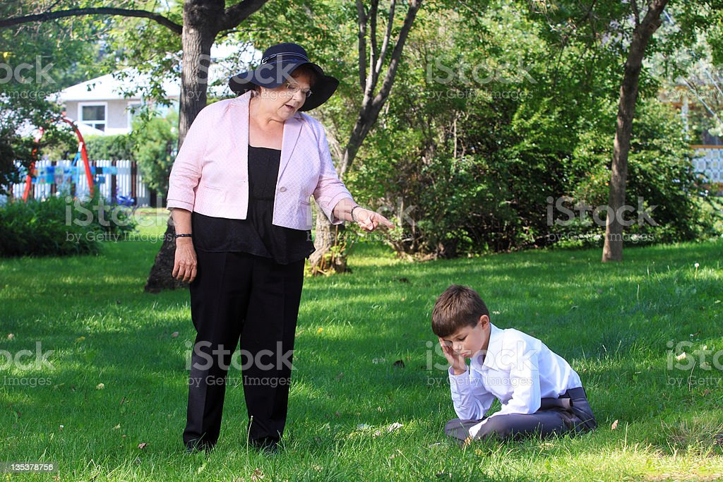 Grandmother argues with his grandchild royalty-free stock photo