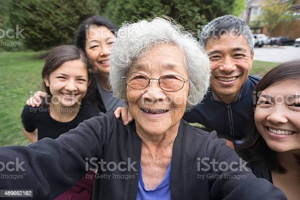 Grandmother children grandchildren pose for selfie care home in picture id489662162?b=1&k=6&m=489662162&s=612x612&h=ax sgv4rux 4haykqfipzbxczee256ebs4v wavb20c=