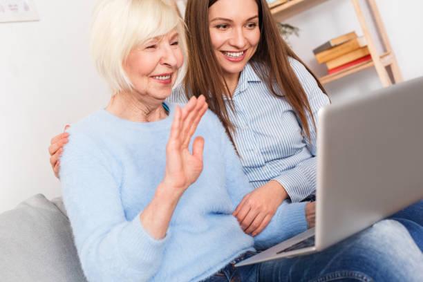 grandmother communicates on skype with her family - skype imagens e fotografias de stock