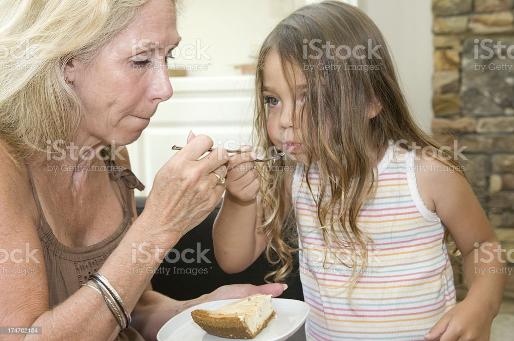 Grandmother eating with grandaughter. royalty-free stock photo