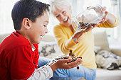 istock Grandmother emptying jar of coins into grandsons hands 108359492