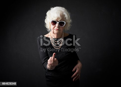 istock Grandmother flipping people off 664626348