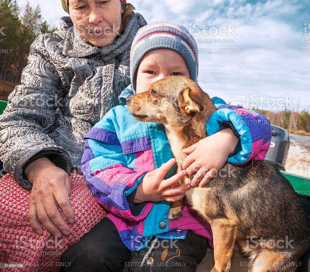 Grandmother, grandson and dog. stock photo