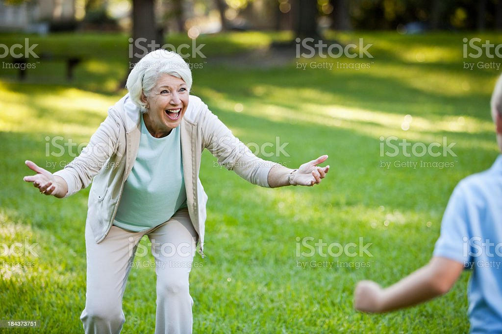 Grandmother greeting grandson with open arms stock photo