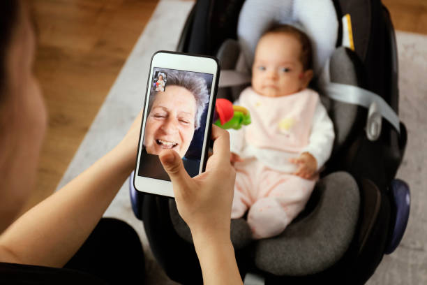 Grandmother having video call with granddaughter Grandmother in quarantine at home talking to her granddaughter homemaker stock pictures, royalty-free photos & images
