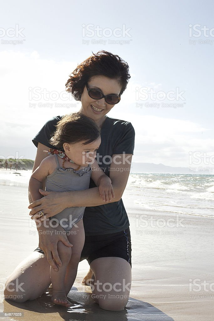 grandmother holding a child on the beach royalty-free stock photo