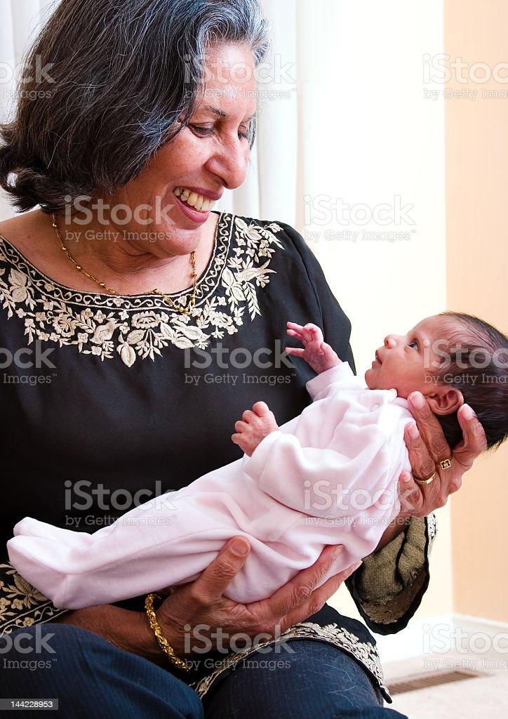Grandmother holding her grandchild stock photo