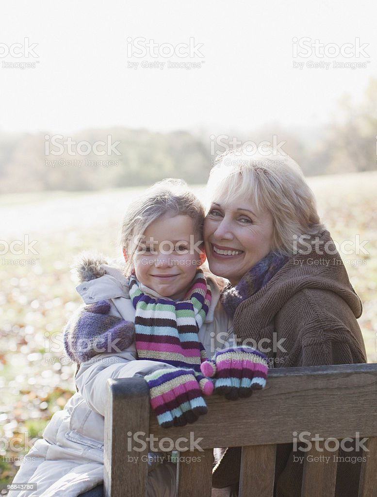 Grandmother hugging granddaughter outdoors royalty-free stock photo