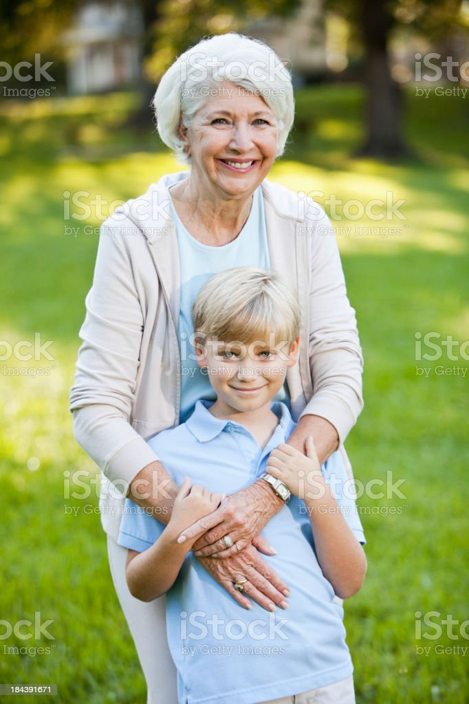 Grandmother hugging grandson royalty-free stock photo