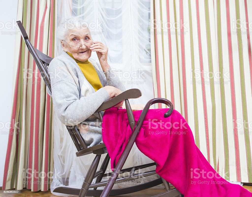 Grandmother in a chair stock photo