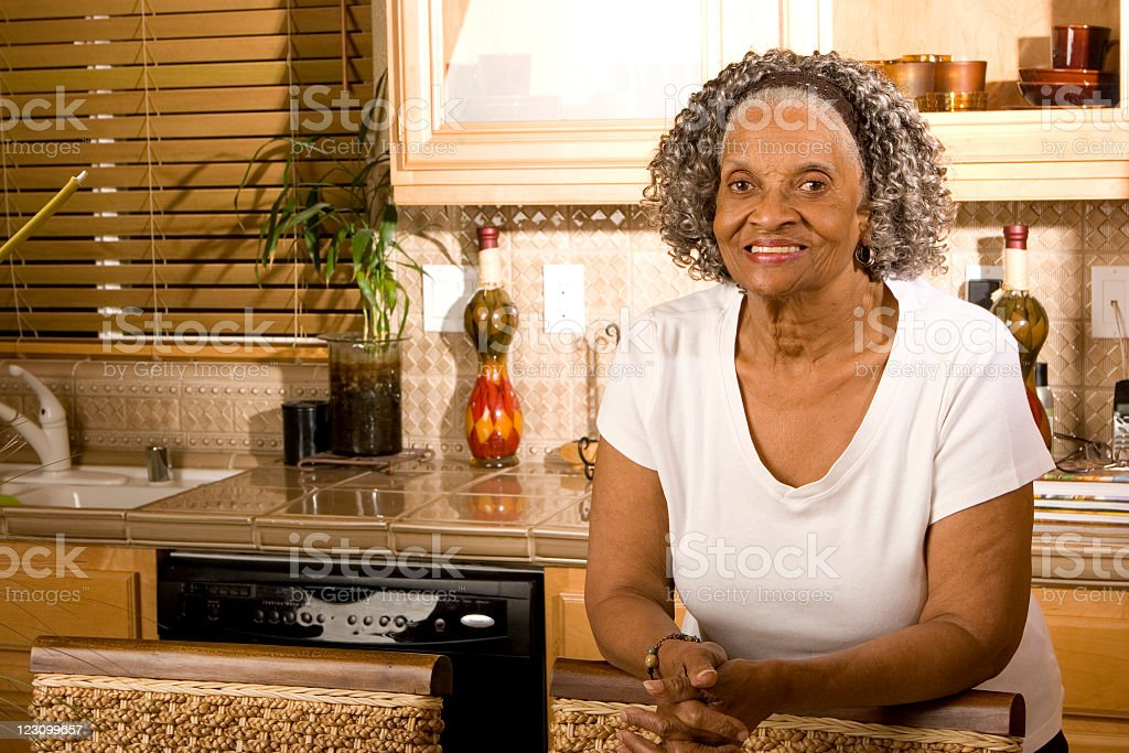 Grandmother in the kitchen royalty-free stock photo