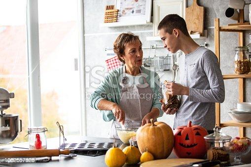 istock Grandmother is baking delicious cookies 1082557828