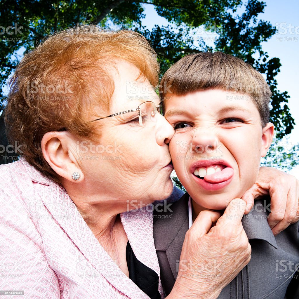 Grandmother kissing her Grandson royalty-free stock photo