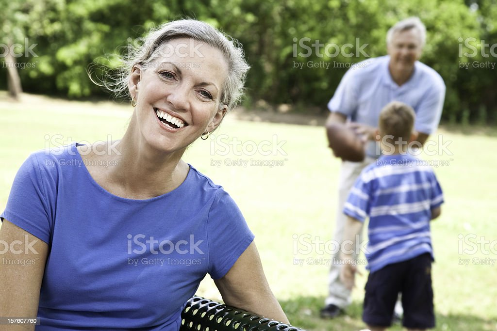 Grandmother Laughing While Grandson plays with Granddad royalty-free stock photo